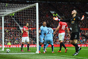 Goalkeepr David De Gea of Manchester United reacts as Sergio Aguero of Manchester City (2L) celebrates with David Silva (21) as he scores their first goal during the Barclays Premier League match between Manchester United and Manchester City at Old Trafford on April 12, 2015 in Manchester, England.