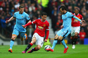 Ander Herrera of Manchester United (C) takes on James Milner (L) and David Silva of Manchester City (R) during the Barclays Premier League match between Manchester United and Manchester City at Old Trafford on April 12, 2015 in Manchester, England.