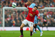 Ander Herrera of Manchester United battles with Fernandinho of Manchester City during the Barclays Premier League match between Manchester United and Manchester City at Old Trafford on April 12, 2015 in Manchester, England.