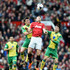 Jonny Howson Photos - Michael Carrick of Manchester United battles with Jonny Howson of Norwich City during the Barclays Premier League match between Manchester United and Norwich City at Old Trafford on April 26, 2014 in Manchester, England. - Manchester United v Norwich City - Premier League