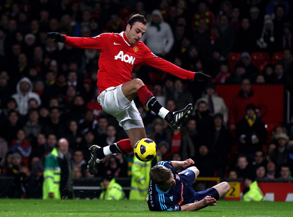 Dimitar Berbatov of Manchester United is challenged by Ryan Shawcross of Stoke City during the Barclays Premier League match between Manchester United and Stoke City at Old Trafford on January 4, 2011 in Manchester, England.