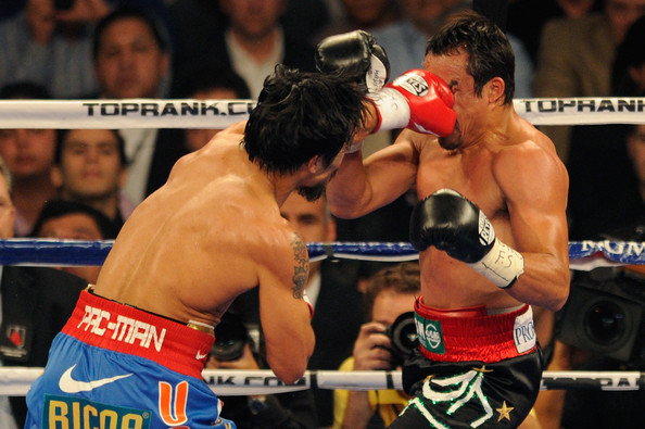Manny Pacquiao v Juan Manuel Marquez [combat sport,sports,contact sport,sport venue,professional boxer,barechested,boxing,boxing ring,striking combat sports,boxing glove,manny pacquiao,juan manuel marquez,v,head,left,l-r,las vegas,nevada,wbo,world welterweight title fight]