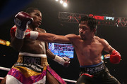 Manny Pacquiao (R) throws a right on Adrien Broner during the WBA welterweight championship at MGM Grand Garden Arena on January 19, 2019 in Las Vegas, Nevada.