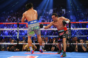(R-L) Juan Manuel Marquez throws a right at Manny Pacquiao during their welterweight bout at the MGM Grand Garden Arena on December 8, 2012 in Las Vegas, Nevada.