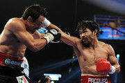 (R-L) Manny Pacquiao throws a right punch at Juan Manuel Marquez during the WBO world welterweight title fight at the MGM Grand Garden Arena on November 12, 2011 in Las Vegas, Nevada.