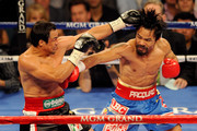 (L-R) Juan Manuel Marquez and Manny Pacquiao exchange blows during the WBO world welterweight title fight at the MGM Grand Garden Arena on November 12, 2011 in Las Vegas, Nevada.