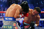 (R-L) Juan Manuel Marquez throws a right to the head of Manny Pacquiao during their welterweight bout at the MGM Grand Garden Arena on December 8, 2012 in Las Vegas, Nevada.