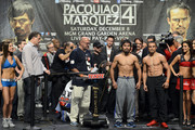 Boxers Manny Pacquiao (L) and Juan Manuel Marquez pose during the official weigh-in for their welterweight bout at the MGM Grand Garden Arena on December 7, 2012 in Las Vegas, Nevada. Pacquiao and Marquez will fight each other for the fourth time on Dec. 8 in Las Vegas.