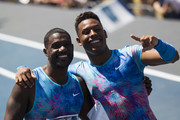 Justin Gatlin of the U.S. and Paulo Andre de Oliveira of Brazil gesture after the Mano a Mano Athletics Challenge at the Brazilian Jockey Club on october 01, 2017 in Rio de Janeiro, Brazil.