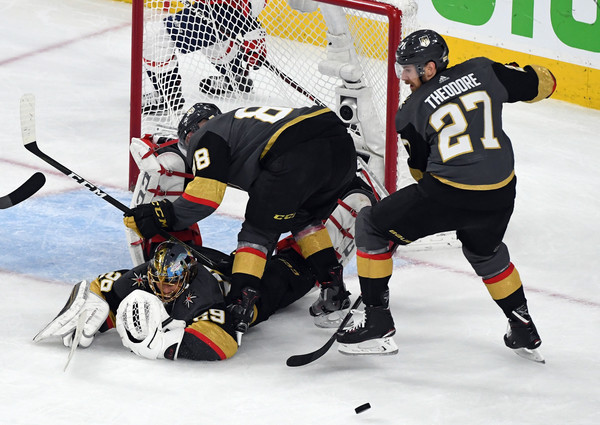 2018 NHL Stanley Cup Final - Game Five [shot,player,college ice hockey,ice hockey,ice hockey position,sports,sports gear,ice hockey equipment,hockey protective equipment,team sport,hockey pants,marc-andre fleury,nate schmidt 88,shea theodore,five,save,vegas golden knights,nhl,washington capitals,stanley cup final]