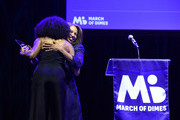 Marlean Felix presents her daughter Allyson Felix with an award at March of Dimes Get S.E.T. Los Angeles at The Novo Theater at L.A. Live on June 27, 2019 in Los Angeles, California.