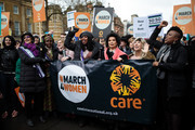 Protesters including Helen Pankhurst (2ndL), great-granddaughter of suffragette leader Emmeline Pankhurst, Labour politician Dawn Butler (4th R) and social and human rights campaigner Bianca Jagger (3rd R) march to Trafalgar Square during the March4Women event on March 4, 2018 in London, England. Demonstrators march through central London today with calls for an end to gender-based discrimination in the workplace. The event celebrates the upcoming International Women's Day, on March 8th, and marks 100 years since the first women in the UK gained the right to vote.