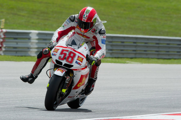 Marco Simoncelli Marco Simoncelli of Italy and San Carlo Honda Gresini heads down a straight during the qualifying practice of MotoGP of Malaysia at Sepang Circuit on October 22, 2011 in Kuala Lumpur, Malaysia.