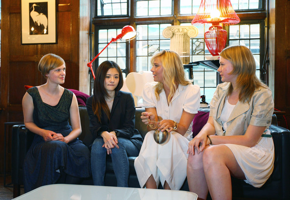 Maria Sharapova, international tennis star and global brand ambassador for Sony Ericsson has a chat with the winning students of London College of Fashion Lova Moller (L), Cecilia Ku (centre left) and the winner Geogrie Davies at Liberty store as she unveils winning designs from students at the London College of Fashion on June 17, 2009 in London, England.