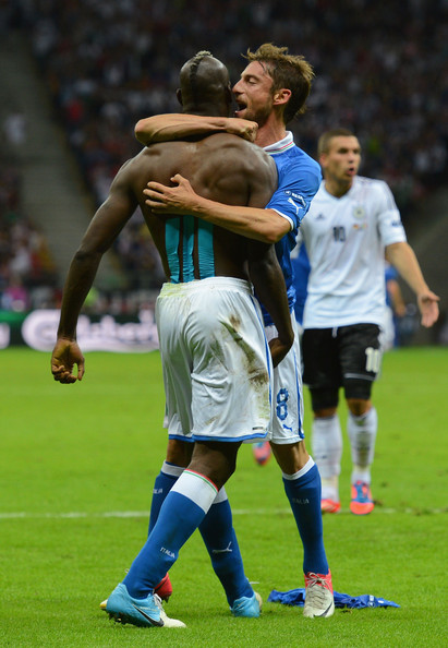 Mario Balotelli Mario Balotelli (L) of Italy celebrates with team-mate Daniele De Rossi after scoring his team's second goal during the UEFA EURO 2012 semi final match between Germany and Italy at the National Stadium on June 28, 2012 in Warsaw, Poland.