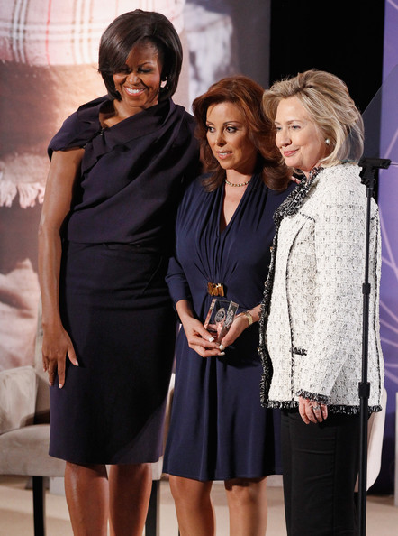 The First Lady And Hillary Clinton Hold The International Women of Courage Awards [hillary clinton,michelle obama,first lady,women,deputy attorney general,winner,r,hillary clinton hold the international women of courage awards,photographs,clothing,fashion,dress,event,little black dress,cocktail dress,fashion design,formal wear,fashion model,performance,u.s.]