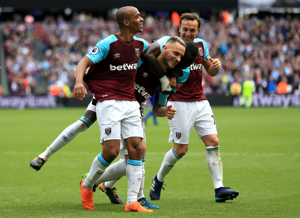 West Ham United vs. Everton - Premier League [player,sports,football player,team sport,ball game,sport venue,soccer player,tournament,football,sports equipment,marko arnautovic,v,sides,goal,center,london stadium,west ham united,everton,premier league,west ham aunited]