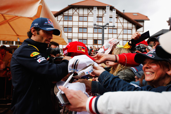 Mark Webber Mark Webber of Australia and Red Bull Racing meets fans at an autograph session following qualifying for the German Formula One Grand Prix at the Nurburgring on July 23, 2011 in Nuerburg, Germany.