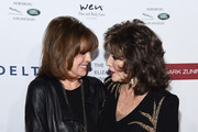 Linda Gray (L) and Dame Joan Collins arrive at a cocktail reception benefiting The Elizabeth Taylor AIDS Foundation at the Mark Zunino Atelier on November 07, 2019 in Beverly Hills, California.