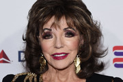 Dame Joan Collins arrives at a cocktail reception benefiting The Elizabeth Taylor AIDS Foundation at the Mark Zunino Atelier on November 07, 2019 in Beverly Hills, California.