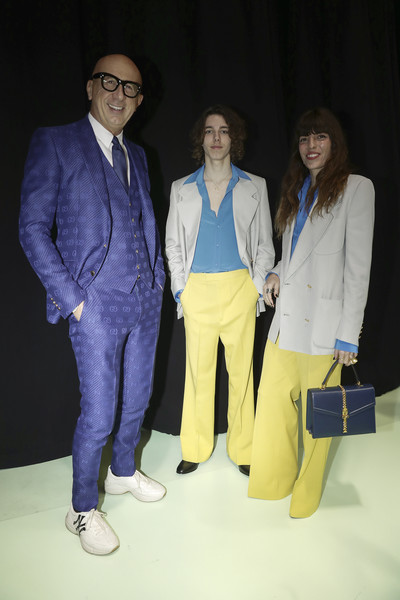 Gucci - Arrivals at Backstage - Milan Fashion Week Fall/Winter 2020/21 [yellow,suit,fashion,event,fun,fashion design,formal wear,outerwear,blazer,electric blue,arrivals,marco bizzarri,marlowe jack tiger mitchell,lou doillon,l-r,gucci backstage,milan,italy,gucci,milan fashion week,tuxedo m.,tuxedo,socialite,glasses]