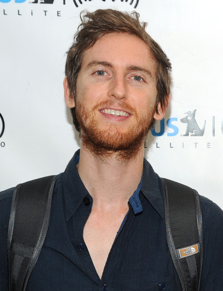 The 38-year old son of father Bob Carmichael and mother(?), 182 cm tall Jesse Carmichael in 2017 photo