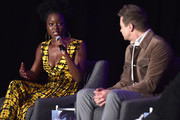 """Danai Gurira (L) and Jeremy Renner speak onstage during Marvel Studios' """"Avengers: Endgame"""" Global Junket Press Conference at the InterContinental Los Angeles Downtown on April 7, 2019 in Los Angeles, California."""