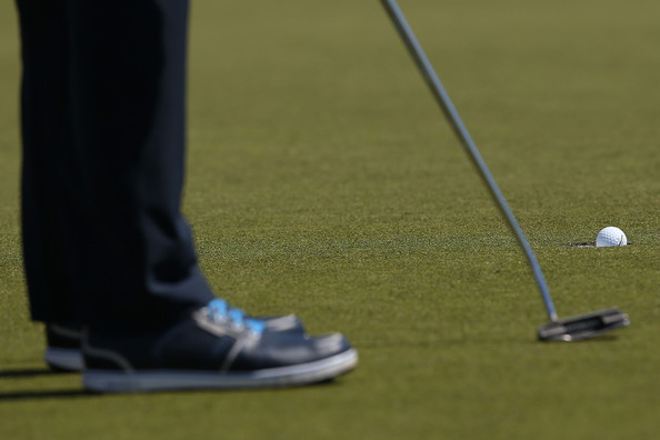 Australian Masters: Day 2 [putter,golf,golf club,golf equipment,sport venue,games,golf ball,recreation,grass,golf course,masters,matt kuchar,putt,australian,usa,melbourne,royal melbourne golf course,round,australian masters]