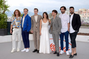 """(L-R) Samuel Gauthier, Antoine Pilon, Pier-Luc Funk, Catherine Brunet, director Xavier Dolan, Gabriel D'Almeida-Freitas and Adib Alkhalidey attend the photocall for """"Matthias et Maxime (Matthias and Maxime)""""during the 72nd annual Cannes Film Festival on May 23, 2019 in Cannes, France."""