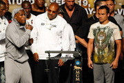 (L-R) Boxer Floyd Mayweather Jr., his advisor Leonard Ellerbe and boxer Juan Manuel Marquez appear during their official weigh-in at the MGM Grand Garden Arena September 18, 2009 in Las Vegas, Nevada. The two will fight at the MGM on September 19.