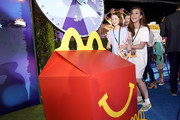 """Alyson Hannigan and family are seen as McDonald's treats guests to Happy Meals at the """"Toy Story 4"""" Premiere After Party at El Capitan Theatre on June 11, 2019 in Los Angeles, California."""