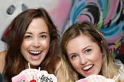 Erika Henningsen and Taylor Louderman of MEAN GIRLS on Broadway attend the Mean Girls CrazyShake launch at Black Tap Craft Burgers and Beer in Midtown on September 12, 2018 in New York City.