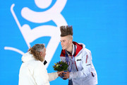 Silver medalist Staale Sandbech of Norwayreceives his flowers from President of the International Ski Federation (FIS) Gian-Franco Kasper during the medal ceremony for the Snowboard Men's Slopestyle  during day 1 of the Sochi 2014 Winter Olympics at Medals Plaza on February 8, 2014 in Sochi, Russia.