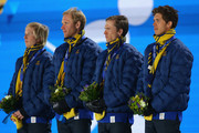 (L-R) Gold medalists Lars Nelson, Daniel Richardsson, Johan Olsson and Marcus Hellner of Sweden celebrate on the podium during the medal ceremony for the Cross Country MenÂ's 4 x 10 km Relay on day ten of the Sochi 2014 Winter Olympics at the Medals Plaza on February 17, 2014 in Sochi, Russia.
