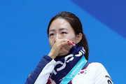 Silver medalist Sang-Hwa Lee of Korea reacts during the medal ceremony for Speed Skating - Ladies' 500m on day 11 of the PyeongChang 2018 Winter Olympic Games at Medal Plaza on February 20, 2018 in Pyeongchang-gun, South Korea.