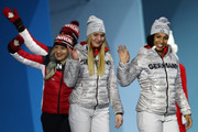 Gold medalists Lisa Buckwitz and Mariama Jamanka of Germany and bronze medalists Phylicia George and Kaillie Humphries of Canada walk on stage for the during the medal ceremony for Bobsleigh - Women on day 13 of the PyeongChang 2018 Winter Olympic Games at Medal Plaza on February 22, 2018 in Pyeongchang-gun, South Korea.