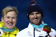 (L-R) Silver medalist Jarryd Hughes of Australia and gold medalist Pierre Vaultier of France celebrate during the medal ceremony for Men's Snowboard Cross Finals on day six of the PyeongChang 2018 Winter Olympic Games at Medal Plaza on February 15, 2018 in Pyeongchang-gun, South Korea.