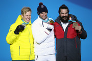 (L-R) Silver medalist Jarryd Hughes of Australia, gold medalist Pierre Vaultier of France and bronze medalist Regino Hernandez of Spain celebrate during the medal ceremony for Men's Snowboard Cross Finals on day six of the PyeongChang 2018 Winter Olympic Games at Medal Plaza on February 15, 2018 in Pyeongchang-gun, South Korea.