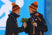 Gold medalist Stefan Groothuis of the Netherlands and bronze medalist Michel Mulder of the Netherlands celebrate during the medal ceremony for the Speed Skating Men's 1000m on day six of the Sochi 2014 Winter Olympics at Medals Plaza on February 13, 2014 in Sochi, Russia.