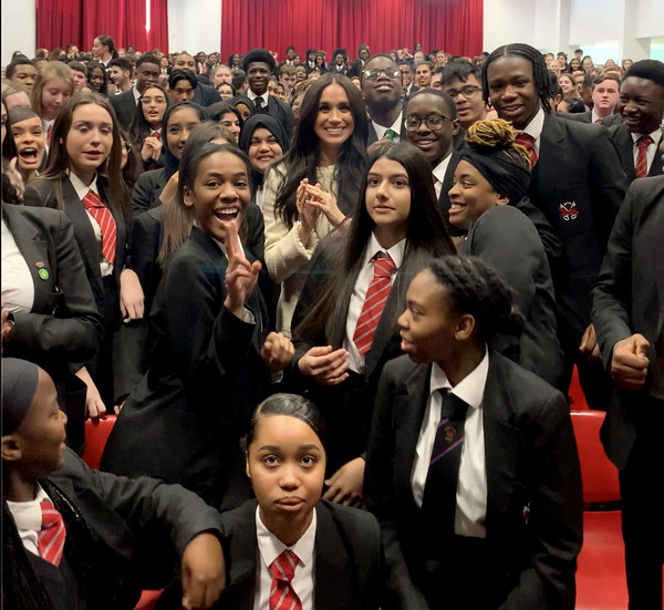 The Duchess Of Sussex Visits The Robert Clack Upper School In Dagenham [handout photo,people,social group,crowd,event,audience,team,businessperson,management,job,employment,credit,commercial use,duchess of sussex,cropping,modification,marketing,dagenham,duchess of sussex visits the robert clack upper school,advertising campaigns,public relations,audience,socialite,public]