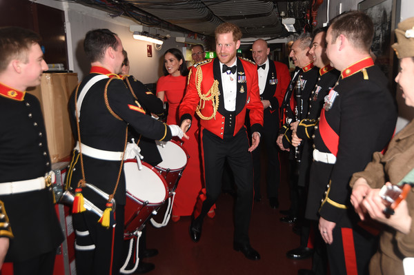 The Duke And Duchess Of Sussex Attend Mountbatten Music Festival [uniform,event,personal protective equipment,team,costume,musical instrument,musical ensemble,harry,meghan,sussex,duchess,royal albert hall,england,duke and duchess of sussex attend mountbatten music festival,duke of sussex,meet band members,mountbatten music festival,profession,uniform,staff capilar y corporal]