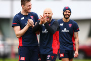 Tom McDonald (L) and Nathan Jones of the Demons react during a Melbourne Demons AFL media opportunity at AAMI Park on September 10, 2018 in Melbourne, Australia.