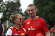 Actress Natalie Portman poses with Melbourne Demons coach Simon Goodwin during a Melbourne Demons AFL training session at Gosch's Paddock on November 28, 2018 in Melbourne, Australia.