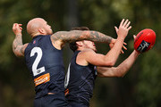 Nathan Jones and Angus Brayshaw compete for the ball during a Melbourne Demons AFL training session at Gosch's Paddock on February 21, 2018 in Melbourne, Australia.