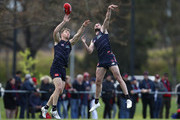 Tim Smith of the Demons and Joel Smith of the Demons compete for the ball during a Melbourne Demons AFL training session at Gosch's Paddock on September 19, 2018 in Melbourne, Australia.