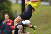 Angus Brayshaw of the Demons marks over the top of Nathan Jones during a Melbourne Demons AFL training session at Gosch's Paddock on December 1, 2017 in Melbourne, Australia.