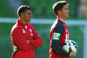 Harry Kewell (R) of the Heart and Heart coach John Aloisi look on during a Melbourne Heart A-League training session at AAMI Park on July 3, 2013 in Melbourne, Australia.