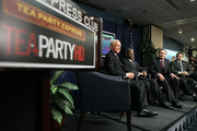 U.S. Sen. Orrin Hatch (R-UT), Rep. Allen West (R-FL), Sen. Mike Lee (R-UT) and Sen. Rand Paul (R-KY) listen during a Tea Party Town Hall meeting February 8, 2011 at the National Press Club in Washington, DC. The town hall meeting was held by the Tea Party Express and Tea Party HD to address issues Tea Party members were concerned over.