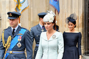 Catherine, Duchess of Cambridge (C), Prince William, Duke of Cambridge (L) and Meghan, Duchess of Sussex (R) attend as members of the Royal Family attend events to mark the centenary of the RAF on July 10, 2018 in London, England.