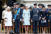 (L-R)  Camilla, Duchess of Cornwall, Prince William, Duke of Cambridge,  Catherine, Duchess of Cambridge, Prince Harry, Duke of Sussex and Meghan, Duchess of Sussex during the RAF 100 ceremony at Buckingham Palace, as members of the Royal Family attend events to mark the centenary of the RAF on July 10, 2018 in London, England.